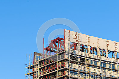Construction worker building scaffold