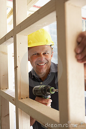 Construction Worker Building Timber Frame In New H