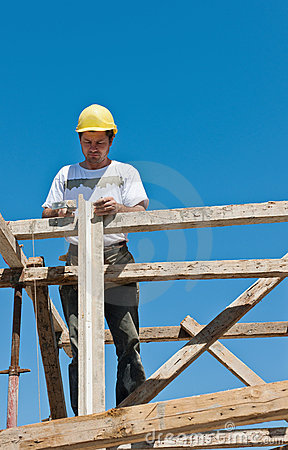 Construction worker busy on formwork preparation