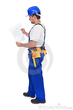 Construction worker checking the blueprints