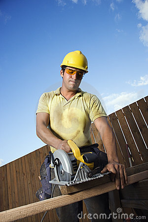 Free Construction Worker Cutting Wood Royalty Free Stock Photography - 12738707