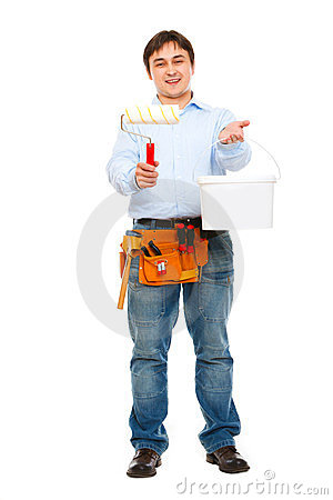 Construction worker giving bucket and brush