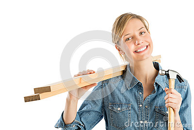 Construction Worker With Hammer Carrying Wooden Planks On Should