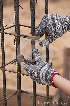 Free Construction Worker Hands Working With Pincers On Fixin Stock Image - 64869101
