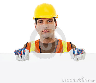 Construction worker holding blank sign