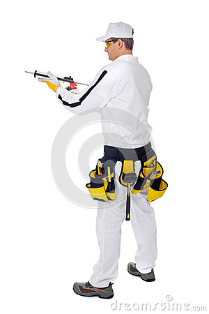 Construction worker holding a gun silicone sealant
