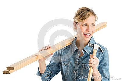 Construction Worker Holding Hammer And Wooden Planks On Shoulder