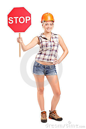 Construction worker holding a traffic sign stop