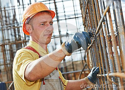 Construction worker making reinforcement