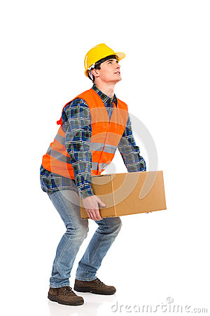 Free Construction Worker Picking Up Heavy Box. Royalty Free Stock Images - 36823949