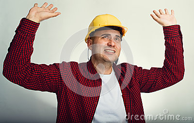 Construction worker with raised hands