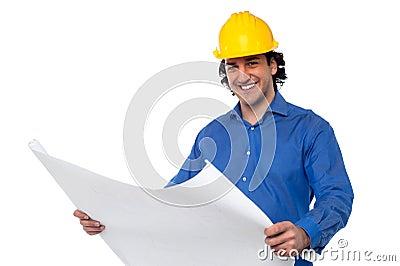 Construction worker reviewing blueprint
