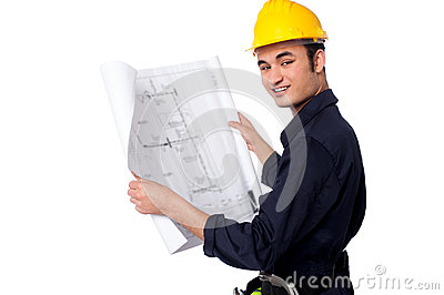 Construction worker reviewing blueprint