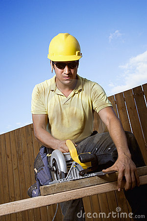 Free Construction Worker Sawing Wood Royalty Free Stock Photos - 12738728