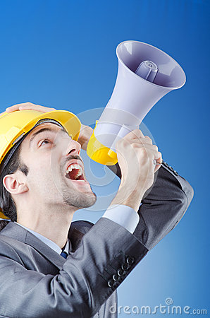 Construction worker shouting with loudspeaker