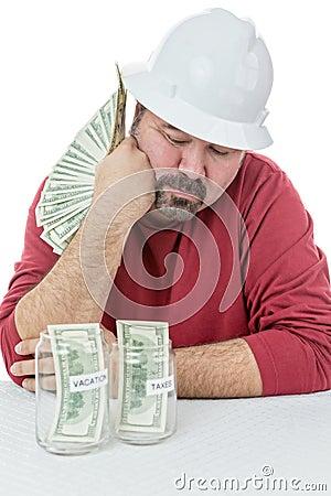 Construction worker splitting money