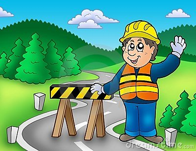 Construction worker standing on road