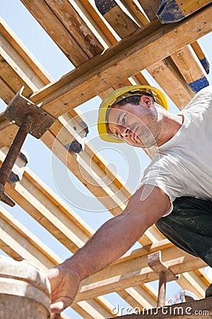 Construction worker under formwork girders