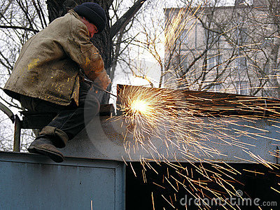 A construction worker welding steel