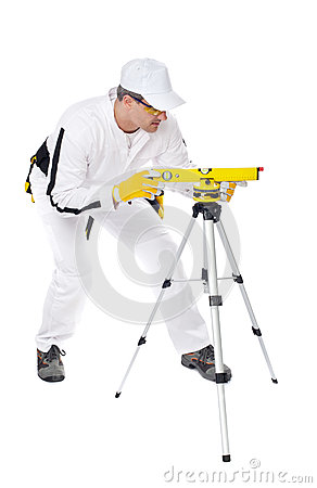 Construction Worker In White Coveralls Level Tool Royalty Free Stock Photo - Image: 25670455