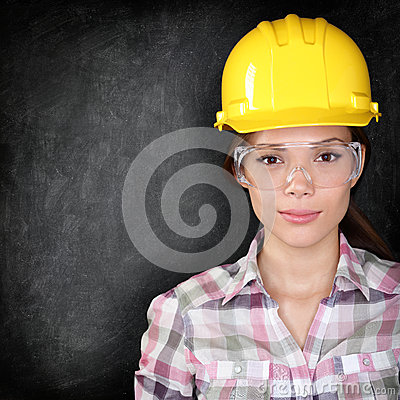 Free Construction Worker Woman On Blackboard Texture Royalty Free Stock Photos - 32538708