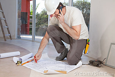 Construction worker working on blueprint