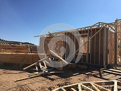 Construction worker working on the framing process for a new a house. Editorial Stock Photo
