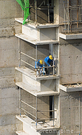 Construction workers at high-r