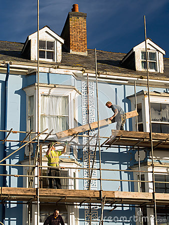 Construction Workers Repairing House Editorial Photo