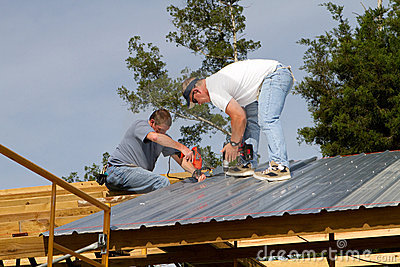 Construction Workers On Roof