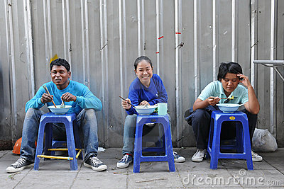 Construction Workers at a Street Restaurant Editorial Stock Image