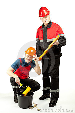 Construction workers in uniform with tools