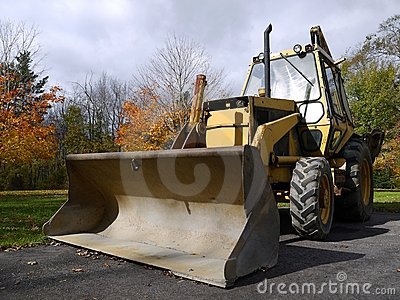 Construction: yellow excavator front h