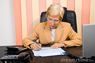 Consultant woman drawing financial graph