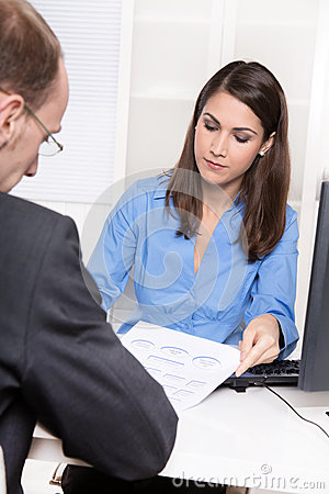 Consulting or business meeting - young businesswoman sales