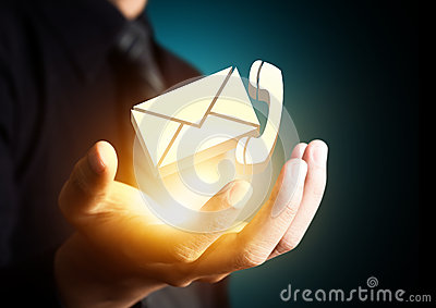 Contact us symbol in businessman hand