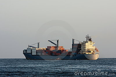 Container cargo ship at sea.