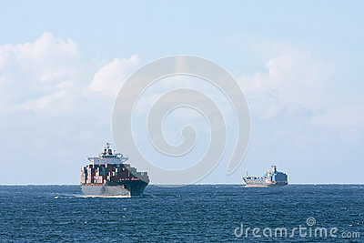 Container cargo ships passing at sea