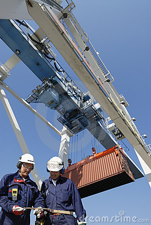 Container port, workers, cranes and trucks