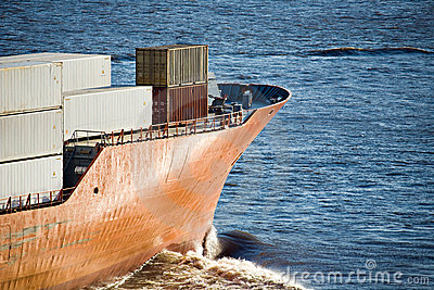 Container ship freighter heading out to sea