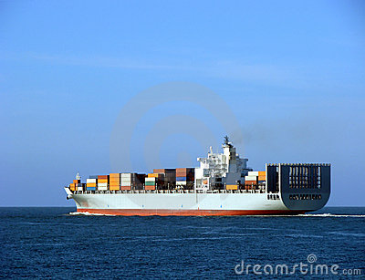 Container Ship with Full Load Sailing Away at Sea