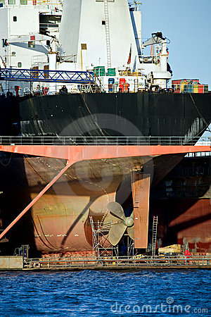 Container ship in harbor dry dock
