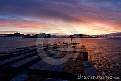 Container ship heads into Prince Rupert at sunrise