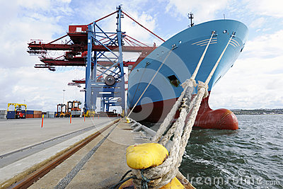 Container ship mored at quay-side Stock Photo