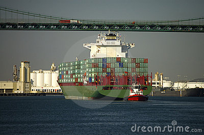 Container Ship Passes Under Bridge