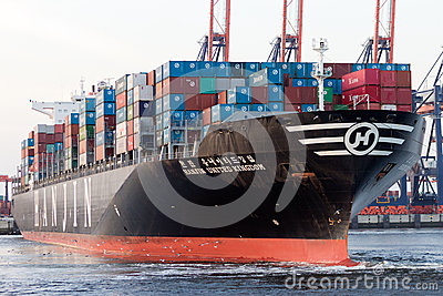 Container ship leaving port Editorial Stock Image