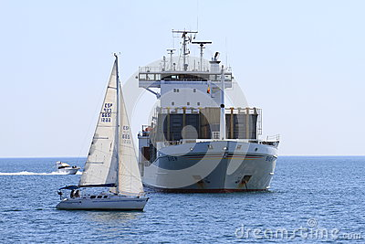 Container ship and sailing boats Editorial Stock Image