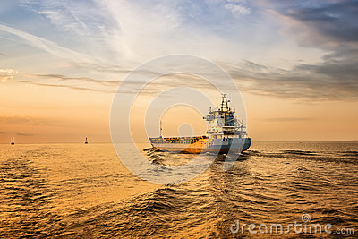 Container Ship on Sea Road during Sunset.