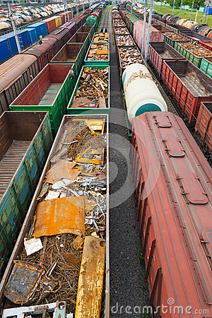Containers and cars at the railroad station