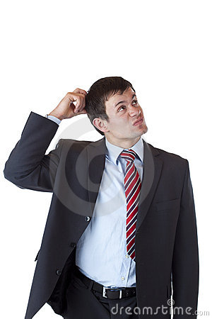 Free Contemplative Businessman Scratches His Head Royalty Free Stock Photos - 19947618